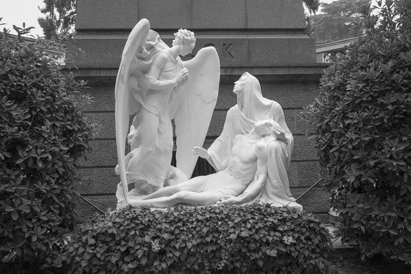 MILAN, ITALY - OCTOBER 22: (EDITORS NOTE: Image was shot in black and white. Color version not available.) Tomb and memorial monument of the Falk family is seen on October 22, 2017 in Milan, Italy. Milan Monumentale Cemetery, was commissioned in 1860 to unite the many small burial grounds throughout the city into one large cemetery, and was the first in Italy and one of the first in Europe to adopt cremation as a practice.  (Photo by Marco Secchi/Getty Images)