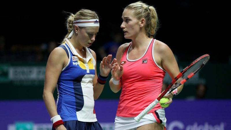 SINGAPORE - OCTOBER 26:  Andrea Hlavackova (L) of Czech Republic and Timea Babos of Hungary talk in their doubles match against Maria Jose Martinez Sanchez of Spain and Andreja Klepac of Slovenia during day 5 of the BNP Paribas WTA Finals Singapore presented by SC Global at Singapore Sports Hub on October 26, 2017 in Singapore.  (Photo by Matthew Stockman/Getty Images)