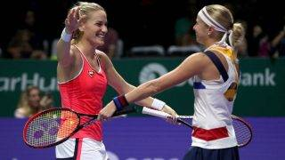 SINGAPORE - OCTOBER 28:  Timea Babos (L) of Hungary and Andrea Hlavackova of Czech Republic celebrate victory in the doubles semi final match against Martina Hingis of Switzerland and Chan Yung-Jan of Chinese Taipei during day 7 of the BNP Paribas WTA Finals Singapore presented by SC Global at Singapore Sports Hub on October 28, 2017 in Singapore.  (Photo by Matthew Stockman/Getty Images)