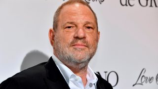 (FILES) This file photo taken on May 23, 2017 shows US film producer Harvey Weinstein posing during a photocall as he arrived to attend the De Grisogono Party on the sidelines of the 70th Cannes Film Festival, at the Cap-Eden-Roc hotel in Antibes, near Cannes, southeastern France.  Hollywood producer Harvey Weinstein issued an apology on October 5, 2017 and announced he was taking leave after the New York Times published a bombshell report accusing him of sexual harassment over several decades. / AFP PHOTO / Yann COATSALIOU