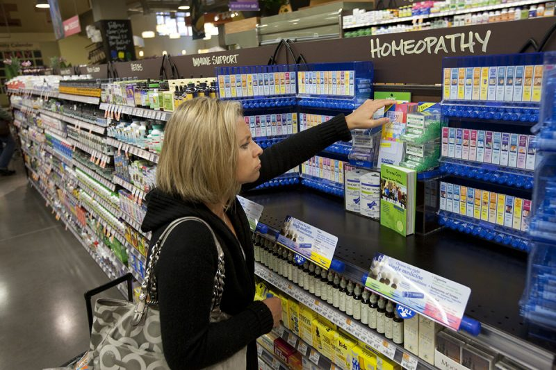 A customer shops for Homeopathy products in the healh section at the new Whole Foods Market in Chevy Chase, Maryland. (Photo by Brooks Kraft LLC/Corbis via Getty Images)
