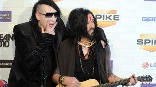 "Musicians Marilyn Manson (L) and Twiggy Ramirez arrive at the 5th annual ""Scream Awards"" at the Greek Theatre in Los Angeles, California on October 16, 2010. AFP PHOTO / GABRIEL BOUYS / AFP PHOTO / GABRIEL BOUYS"