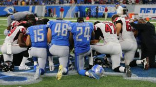 DETROIT, MI - SEPTEMBER 024: Members of  the Detroit Lions and the Atlanta Falcons kneeling in prayer on the field at Ford Field on September 024, 2017 in Detroit, Michigan. (Photo by Rey Del Rio/Getty Images)