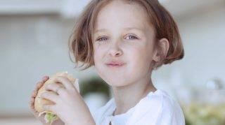 Beautiful Young Girl eating sandwich