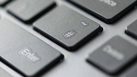 Close up view of hashtag key icon on a computer keyboard keys.