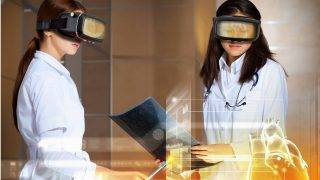 20382954 - image of two attractive women cardiologist examining virtual heart