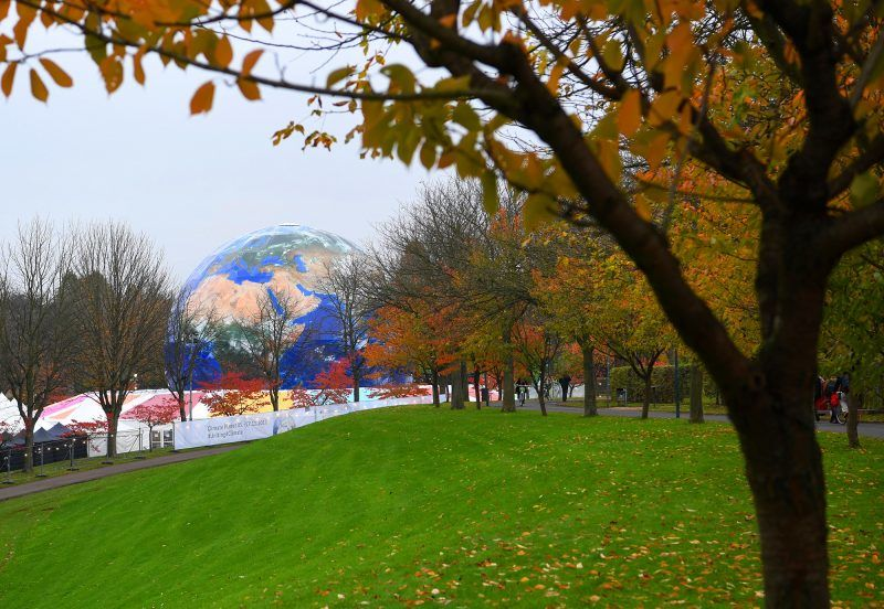 A picture taken on November 6, 2017 shows an earth mockup displayed at the Rheinaue park during the COP23 United Nations Climate Change Conference in Bonn, Germany. / AFP PHOTO / PATRIK STOLLARZ