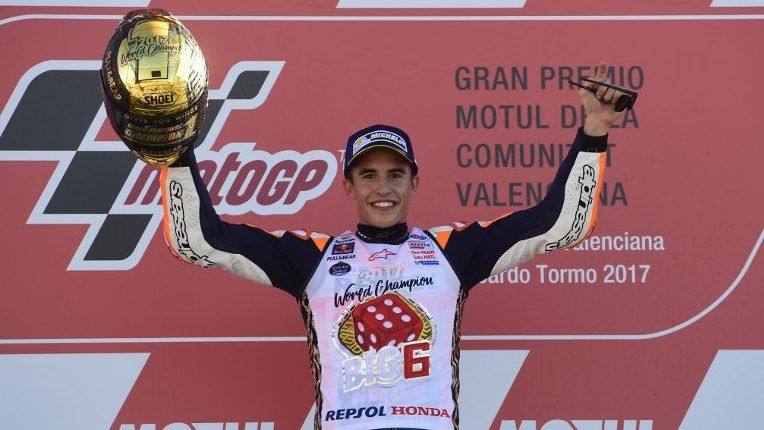 Repsol Honda Team's Spanish rider Marc Marquez celebrates on the podium of the MotoGP race of the Valencia Grand Prix at Ricardo Tormo racetrack in Cheste, near Valencia on November 12, 2017.  Spain's Marc Marquez sealed his sixth world championship and fourth in the premier MotoGP category with third place at the Valencia Grand Prix. Marquez's Honda teammate Dani Pedrosa won the race from France's Johann Zarco in second.  / AFP PHOTO / PIERRE-PHILIPPE MARCOU