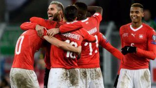Swiss players celebrates their qualification at the end of the FIFA 2018 World Cup play-off second leg football match between Switzerland and Northern Ireland at St. at St. Jakob-Park Stadium on November 12, 2017. / AFP PHOTO / Fabrice COFFRINI