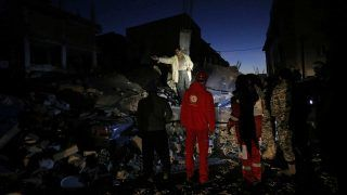 Rescue personnel conduct search and rescue work following a 7.3-magnitude earthquake at Sarpol-e Zahab in Iran's Kermanshah province on November 13, 2017.At least 164 people were killed and 1,600 more injured when a 7.3-magnitude earthquake shook the mountainous Iran-Iraq border triggering landslides that were hindering rescue efforts, officials said.  / AFP PHOTO / ISNA / POURIA PAKIZEH