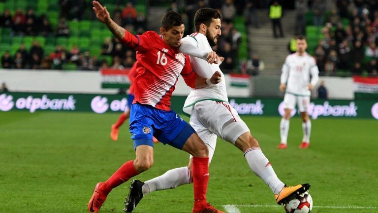 Costa Rica's Cristian Gamboa (L) vies with Hungary's Daniel Nagy vie for the ball during the international friendly football match Hungary v Costa Rica in Budapest, on November 14, 2017.  / AFP PHOTO / ATTILA KISBENEDEK