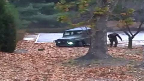 """This screengrab made from video footage released by the United Nations Command on November 22, 2017 shows a North Korea defector running out from a vehicle at the Joint Security Area of the Demilitarized Zone (DMZ).Dramatic footage of a North Korean soldier's defection released on November 22 showed him racing across the border under fire from former comrades, and then being hauled to safety by South Korean troops. The defector, who ran across the border at the Panmunjom truce village on November 13, was shot at least four times and has been recovering in a South Korean hospital. / AFP PHOTO / UNITED NATIONS COMMAND / Handout / RESTRICTED TO EDITORIAL USE - MANDATORY CREDIT """"AFP PHOTO / UNITED NATIONS COMMAND (UNC)"""" - NO MARKETING NO ADVERTISING CAMPAIGNS - DISTRIBUTED AS A SERVICE TO CLIENTS"""