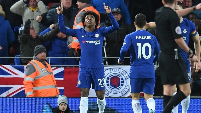 Chelsea's Brazilian midfielder Willian (C) celebrates after scoring their first goal during the English Premier League football match between Liverpool and  Chelsea at Anfield in Liverpool, north west England on November 25, 2017. / AFP PHOTO / Paul ELLIS / RESTRICTED TO EDITORIAL USE. No use with unauthorized audio, video, data, fixture lists, club/league logos or 'live' services. Online in-match use limited to 75 images, no video emulation. No use in betting, games or single club/league/player publications.  /