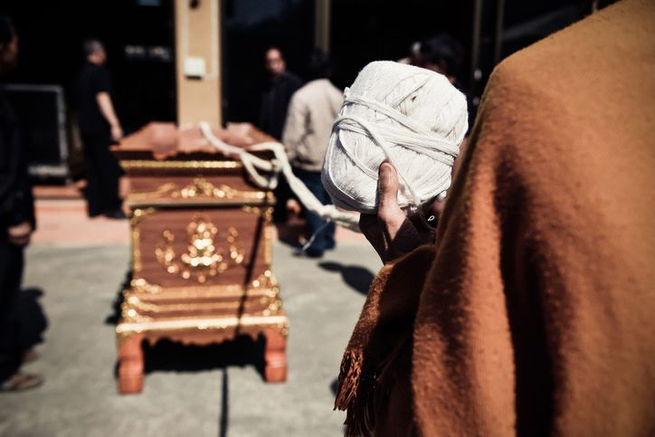 Thai buddhism monk religious prayingl for the cremation. The corpse in the coffin prepared for burning in the cremate.