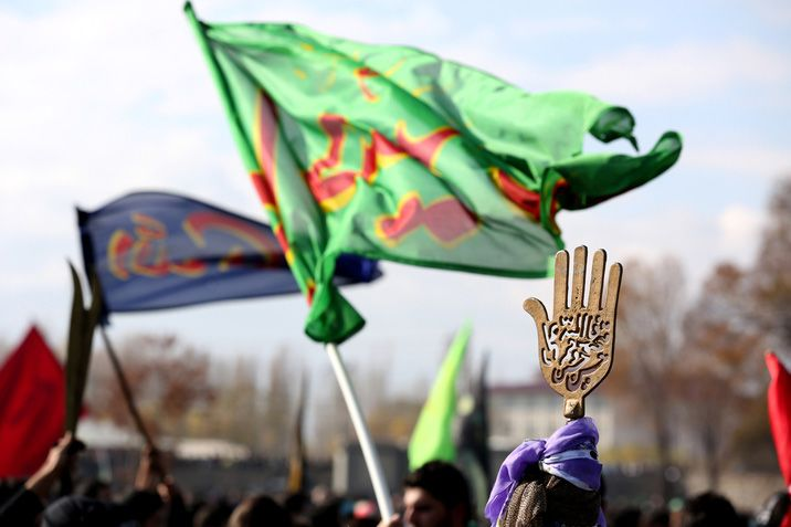 Shiite-Jafari Muslim flags and signs in a religious procession in Turkey.