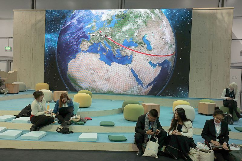 Participants in the World Climate Conference working in front of the depiction of a globe in Bonn, Germany, 07 November 2017. The World Climate Conference COP23 takes place in Bonn between 06 until 17 November 2017. Photo: Oliver Berg/dpa
