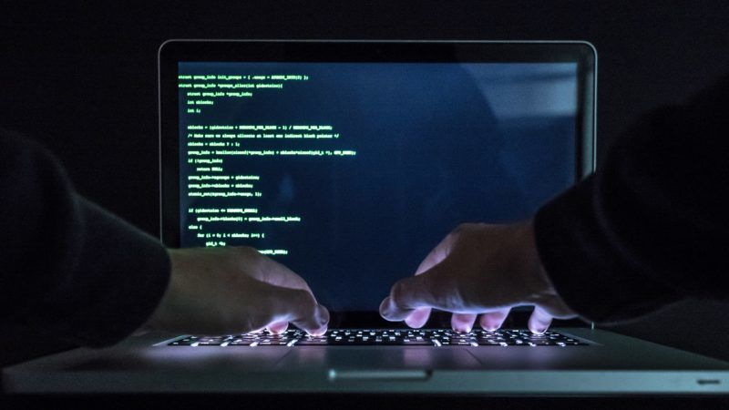 FILE - ILLUSTRATION - A man types on an illuminated keyboard of a laptop in Rottweil, Germany, 2 November 2017. Photo: Silas Stein/dpa