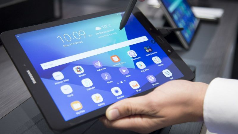 BARCELONA, SPAIN - FEBRUARY 27: Visitors examine the new Samsung's Galaxy TAB devices during the Mobile World Congress 2017 in Barcelona, Spain on February 27, 2017. Albert Llop / Anadolu Agency