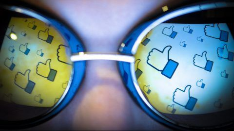 """The Facebook """"thumbs up"""" or """"lie"""" gesture is seen reflected in a pair of sunglasses on November 3, 2017. (Photo by Jaap Arriens/NurPhoto)"""