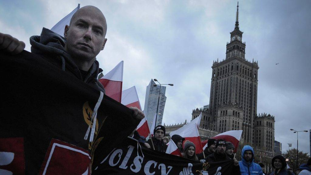 People are seen in the center of Warsaw on November 11, 2017 ahead of the Independence Day march. An estimated 60 thousand people joined the traditional Independence Day march in the Polish capital on Saturday amidst fears the rally increasingly attracts fascists from foreign countries. (Photo by Jaap Arriens/NurPhoto)