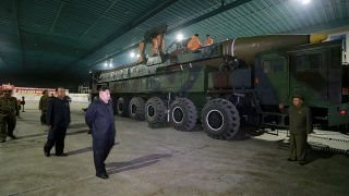 FILE PHOTO: North Korean leader Kim Jong Un inspects the intercontinental ballistic missile Hwasong-14 in this undated photo released by North Korea's Korean Central News Agency (KCNA) in Pyongyang July 5, 2017. KCNA/via REUTERS/File Photo    ATTENTION EDITORS - THIS IMAGE WAS PROVIDED BY A THIRD PARTY. REUTERS IS UNABLE TO INDEPENDENTLY VERIFY THIS IMAGE. NO THIRD PARTY SALES. SOUTH KOREA OUT.