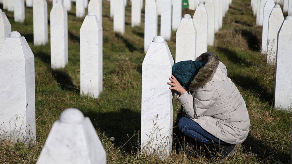 A woman reacts near a grave of her family members in the Memorial centre Potocari near Srebrenica, Bosnia and Herzegovina, after the court proceedings of former Bosnian Serb general Ratko Mladic, November 22, 2017. REUTERS/Dado Ruvic