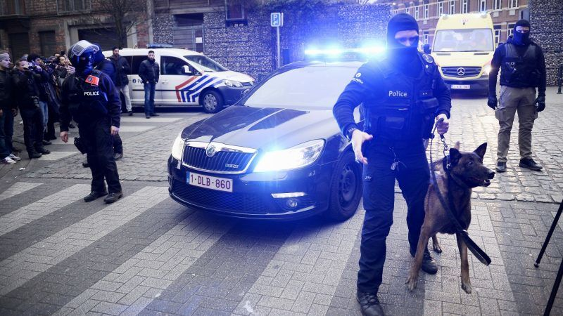 Policemen block a road, near the scene of a police raid in the Molenbeek-Saint-Jean district in Brussels, on March 18, 2016, as part of the investigation into the Paris November attacks. The main suspect in the jihadist attacks on Paris in November, Salah Abdeslam, was arrested in a raid in Brussels on March 18, French police sources said. / AFP PHOTO / BELGA / DIRK WAEM / Belgium OUT