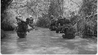 VIETNAM WAR-25TH ANNIVERSARY: Marines of Company H, 2nd Battalion, 4th Marine Regiment take to the water as they move to join up with other elements of their battalion in Dong Ha, Vietnam 0n July 1966. AFP PHOTO/NATIONAL ARCHIVES / AFP PHOTO / NATIONAL ARCHIVES / NATIONAL ARCHIVES