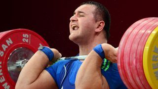 Ruslan Albegov of Russia competes in the men's +105 kg weightlifting IWF World Championships at Centennial Hall in Wroclaw, Poland on October 27, 2013. Ruslan Albegov won the gold medal in the competition. AFP PHOTO/JANEK SKARZYNSKI / AFP PHOTO / JANEK SKARZYNSKI