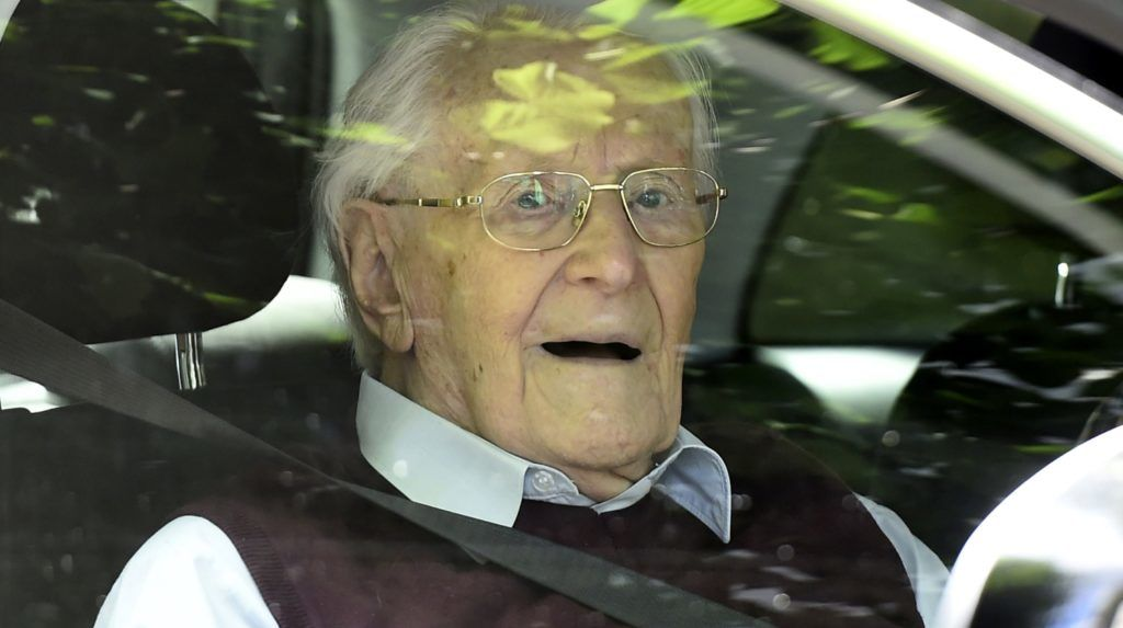 """A convicted former SS officer Oskar Groening leaves after the verdict in his trial on July 15, 2015 at court in Lueneburg, northern Germany. Oskar Groening, 94, sat impassively as judge Franz Kompisch said """"the defendant is found guilty of accessory to murder in 300,000 legally connected cases"""" of deported Jews who were sent to the gas chambers in 1944.  AFP PHOTO / TOBIAS SCHWARZ / AFP PHOTO / TOBIAS SCHWARZ"""