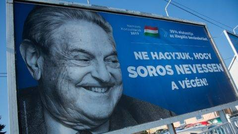 A poster with US billionaire George Soros is pictured on July 6, 2017 in Szekesfehervar, Hungary. The Hungarian government announced on July 12, 2017 that it would end its billboard campaign targeting the US billionaire George Soros which is considered by Jewish organizations as likely to fuel anti-Semitic sentiments. / AFP PHOTO / ATTILA KISBENEDEK