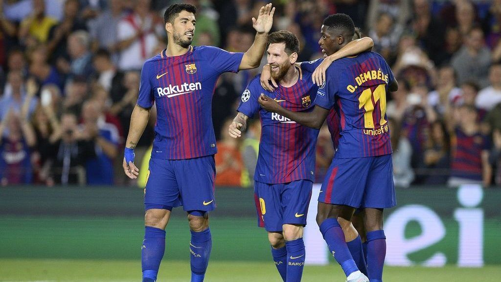 Barcelona's forward from Argentina Lionel Messi (C) celebrates with Barcelona's forward from Uruguay Luis Suarez (L) and Barcelona's forward from France Ousmane Dembele after scoring during the UEFA Champions League Group D football match FC Barcelona vs Juventus at the Camp Nou stadium in Barcelona on September 12, 2017. / AFP PHOTO / Josep LAGO