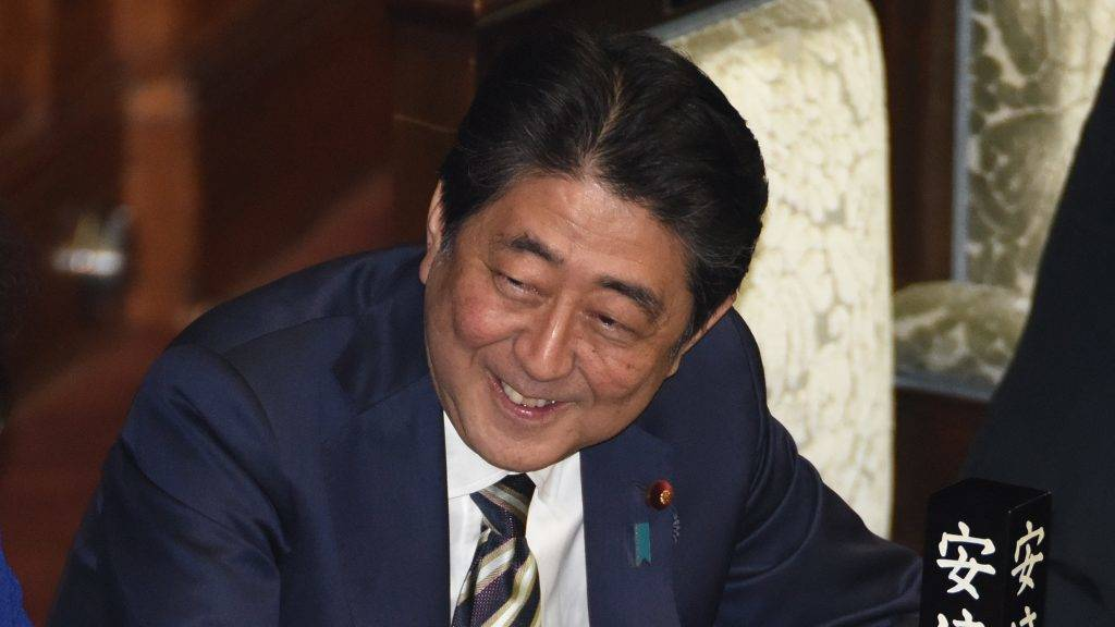 Japanese Prime Minister Shinzo Abe gestures at the lower house of parliament in Tokyo on November 1, 2017. Japan's parliament will formally re-elected Abe as prime minister after his party's crushing election victory, setting the 63-year-old on track to become the country's longest-serving premier. / AFP PHOTO / TORU YAMANAKA
