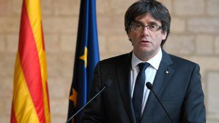 (FILES) This file photo taken on October 26, 2017 shows Catalan president Carles Puigdemont making a statement at the Generalitat (Catalan government headquarters) in Barcelona. The Spanish judge leading the investigation into Catalan separatists will issue on November 3, 2017 a European arrest warrant for ex-leader Carles Puigdemont, who has fled to Belgium, a judicial source in Madrid told AFP. The expected move against Puigdemont, who was dismissed last week as Catalan president by the Spanish government, comes after eight ministers of Catalonia's deposed government were detained pending further probes into their role in the independence drive.     / AFP PHOTO / LLUIS GENE