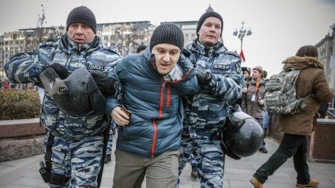 "Russian police detain an opposition activist during a protest rally in central Moscow on November 5, 2017. Russian police said they detained 263 activists gathering in central Moscow for an unauthorised protest against President Vladimir Putin called by a radical opposition activist. Opposition politician Vyacheslav Maltsev had appealed on his website for his supporters to hold protests across the country, calling for a ""people's Revolution"" and an immediate end to Putin's rule.  / AFP PHOTO / Maxim ZMEYEV"
