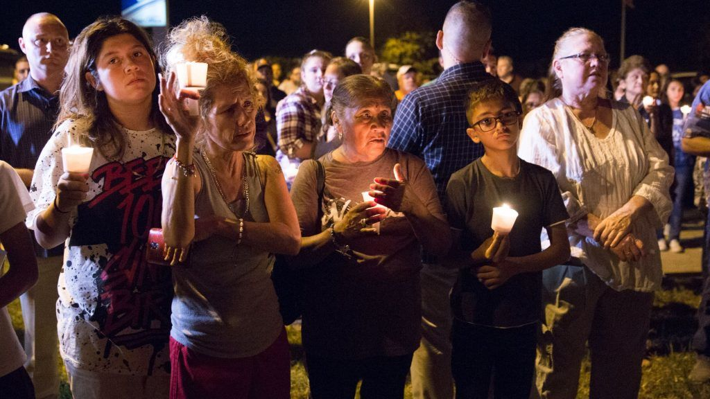 A candlelight vigil is observed on November 5, 2017, following the mass shooting at the First Baptist Church in Sutherland Springs, Texas, that left 26 people dead according to authorities. / AFP PHOTO / SUZANNE CORDEIRO