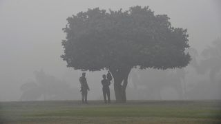Indian security personnel stand guard at the Rajghat memorial amid heavy smog in New Delhi on November 7, 2017. New Delhi woke up to a choking blanket of smog on November 7 as air quality in the world's most polluted capital city reached hazardous levels. The US embassy website said levels of the fine pollutants known as PM2.5 that are most harmful to health reached 703 -- well over double the threshold of 300 which authorities class as hazardous.   / AFP PHOTO / PRAKASH SINGH