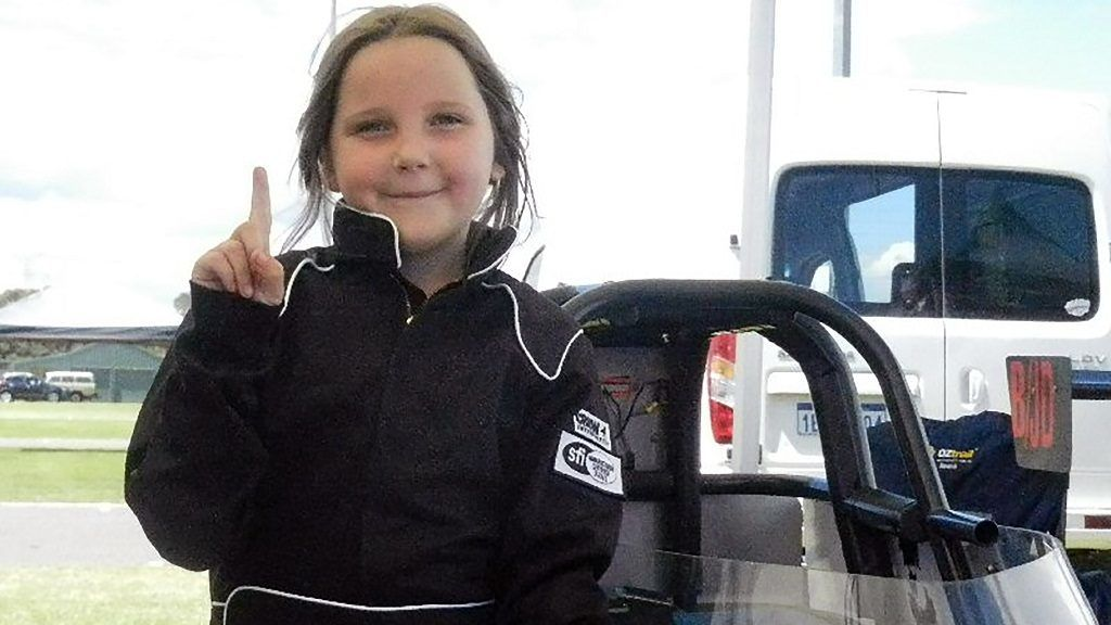 """This handout photo from Junior Dragster Australia taken on October 14, 2017 and received on November 13, 2017 shows eight-year-old Anita Board next to her junior dragster racing car. The young girl died after crashing her junior dragster during a test run in Western Australia, police said on November 13 after she hit a cement barrier at the end of the run in the city of Perth, they said. / AFP PHOTO / Junior Dragster Australia / MIKE SPRLYAN / RESTRICTED TO EDITORIAL USE - MANDATORY CREDIT """"MIKE SPRLYAN / JUNIOR DRAGSTER AUSTRALIA"""" - NO MARKETING NO ADVERTISING CAMPAIGNS - DISTRIBUTED AS A SERVICE TO CLIENTS == NO ARCHIVE"""