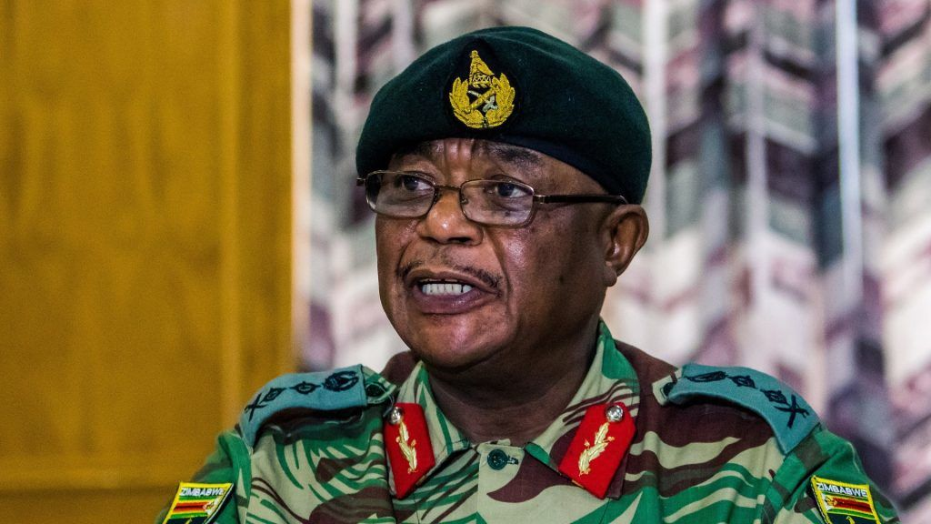 "Zimbabwe Army General Constantino Chiwenga Commander of the Zimbabwe Defence Forces addresses a media conference held at the Zimbabwean Army Headquarters on November 13, 2017 in Harare. Zimbabwe's army chief on November 13 demanded a ""stop"" to the purge in the ruling ZANU-PF party after the sacking of vice president Emmerson Mnangangwa, and warned the military could intervene. / AFP PHOTO / Jekesai NJIKIZANA"