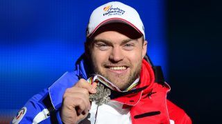 (FILES) This file photo taken on February 9, 2013 shows France's David Poisson holding his bronze medal during the medal ceremony after the men's downhill event of the 2013 Ski World Championships in Schladming, Austria. Skier David Poisson, 35, a World Championship bronze medalist in 2013, died on November 13, 2017 after a crash during a downhill training at the Canadian Nakiska Station, announced the French Ski Federation (FFS). / AFP PHOTO / Olivier MORIN