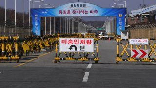 A barricade is set on the road leading to the truce village of Panmunjom at a South Korean military checkpoint in the border city of Paju near the Demilitarized Zone (DMZ) dividing the two Koreas on November 14, 2017. A North Korean soldier involved in an extremely rare and dramatic defection to the South was shot six times by his own side as he drove to the heavily guarded border and ran across under a hail of bullets. / AFP PHOTO / JUNG Yeon-Je