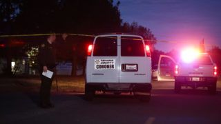 A Tehama County Coroner's van enters the Rancho Tehama Elementary school grounds after a shooting on November 14, 2017, in Rancho Tehama, California Four people were killed and nearly a dozen were wounded, including several children, when a gunman went on a rampage at multiple locations, including a school in rural northern California. / AFP PHOTO / Elijah Nouvelage