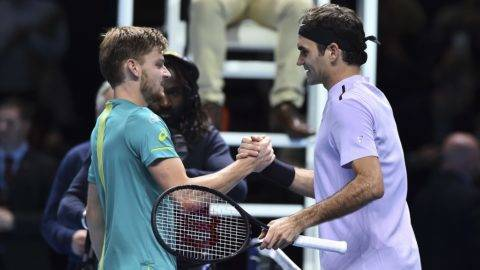 Belgium's David Goffin (L) shakes hands after beating Switzerland's Roger Federer (R) during their men's singles semi-final match on day seven of the ATP World Tour Finals tennis tournament at the O2 Arena in London on November 18, 2017. David Goffin won 2-6, 6-3, 6-4.  / AFP PHOTO / Glyn KIRK