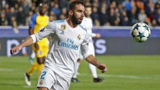 Real Madrid's Spanish defender Dani Carvajal advances with the ball during the UEFA Champions League Group H match between Apoel FC and Real Madrid on November 21, 2017, in the Cypriot capital Nicosia's GSP Stadium.  / AFP PHOTO / Jack GUEZ