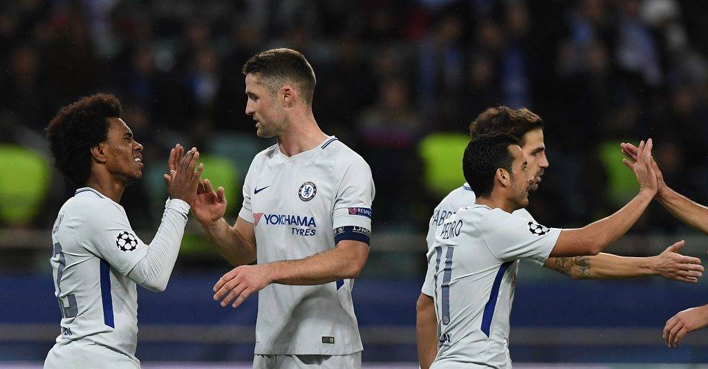 Chelsea's midfielder from Brazil Willian (L) celebrates after scoring the team's fourth goal during the UEFA Champions League Group C football match between Qarabag FK and Chelsea FC in Baku on November 22, 2017. / AFP PHOTO / Kirill KUDRYAVTSEV