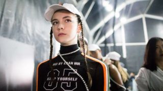 """Russian model Vlada Dzyuba displays a new creation at the fashion show of HUI BY ERAN HUI during the Shanghai Fashion Week Spring/Summer 2018 in Shanghai, China, 13 October 2017.  The Chinese agency representing a 14-year-old Russian model who died after taking part in Shanghai Fashion Week has denied allegations that she was overworked and exhausted. The death of the teenager in a Chinese hospital on Friday has shone a light on the murky world of western models in China, many of whom are from the former Soviet Union. Vlada Dzyuba began feeling dizzy and started being sick last Tuesday and was taken to a Shanghai hospital the next day, but died on Friday after her condition quickly deteriorated. English-language The Siberian Times alleged that Dzyuba died of meningitis compounded by severe exhaustion. """"We feel sorry that we lost an angel,"""" ESEE Model Management in Shanghai said in a statement on Weibo, China's equivalent of Twitter, pointing out that Shanghai Fashion Week ended on October 18 but she fell ill six days later."""