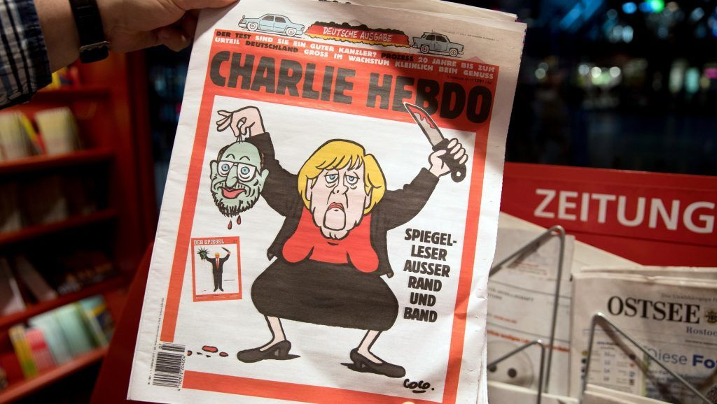 ILLUSTRATION - A man holds up latest German edition of the French satirical magazine 'Charlie Hebdo' in a newspaper shop in Berlin, Germany, 09 February 2017. Photo: Kay Nietfeld/dpa