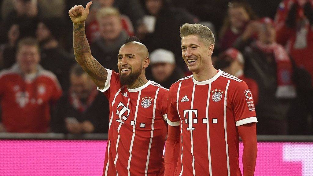 Munich's Robert Lewandowski cheers over his 3-0 score with Arturo Vidal during the Bundesliga soccer match between Bayern Munich and FC Augsburg at the Allianz Arena in Munich, Germany, 18 November 2017.   (EMBARGO CONDITIONS - ATTENTION: Due to the accreditation guidlines, the DFL only permits the publication and utilisation of up to 15 pictures per match on the internet and in online media during the match.) Photo: Angelika Warmuth/dpa