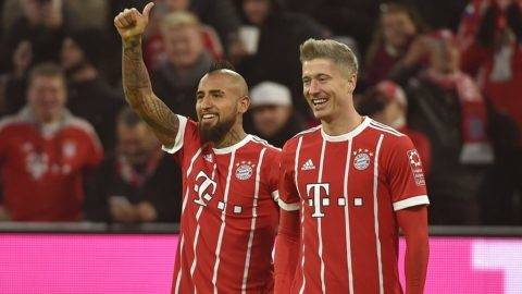 Munich's Robert Lewandowski cheers over his 3-0 score with Arturo Vidal during the Bundesliga soccer match between Bayern Munich and FC Augsburg at the Allianz Arena in Munich, Germany, 18 November 2017. 