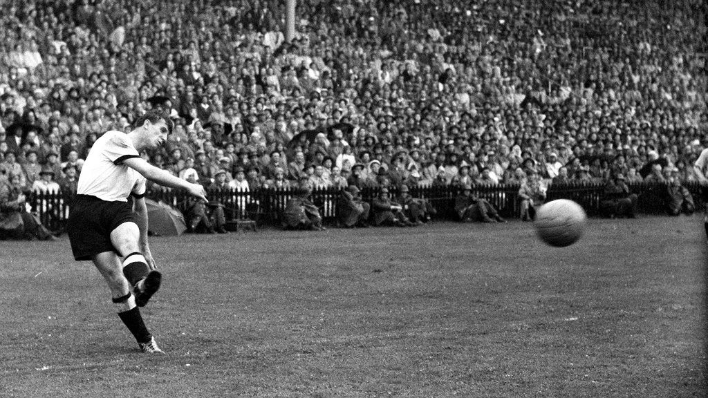 German striker Hans Schäfer performs a free kick during the final match of the world championship on the 4th of July in 1954 in Bern. The German national soccer team won the world champion title against Hungary with a 3:2.